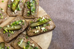 Homemade lard and pickled gherkin on a slices of bread Royalty Free Stock Photos