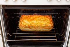 Homemade lasagna in a transparent glass form cooked in the oven on home cuisine. Mediterranean italian food royalty free stock photo