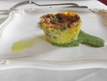 Homemade lasagna with vegetables and italian cheese called pecorino served on a white plate Stock Photo