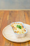 Homemade lasagne bolognese on wood table stock image