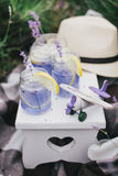 Homemade lavender lemonade with fresh lemons on a white wooden tray Stock Images