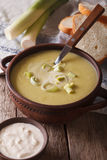 Homemade leek soup in a bowl close-up on the table. vertical Stock Images