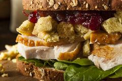 Homemade Leftover Thanksgiving Dinner Turkey Sandwich. With Cranberries and Stuffing stock image