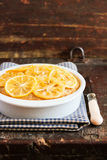 Homemade lemon cake with candied lemon sliced fruit in a bowl on a wooden table Royalty Free Stock Image