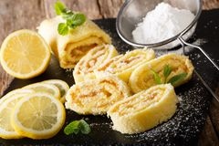 Homemade lemon cake with fruit cream, decorated with mint and po royalty free stock images