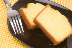 Homemade Lemon Cake Served on A Black Colored Plate Royalty Free Stock Images