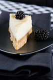 Homemade lemon cheesecake with blackberries Stock Photos
