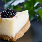 Homemade lemon cheesecake with half a blackberry Royalty Free Stock Photography