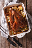 Homemade lemon chicken with herbs in a baking dish. vertical top Stock Photos