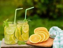 Homemade lemon and lime drink. The process of cooking lemonade in the open air royalty free stock image