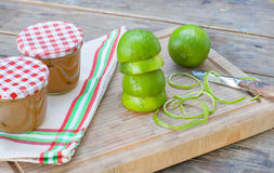 Homemade lime jam with fresh limes Royalty Free Stock Photo