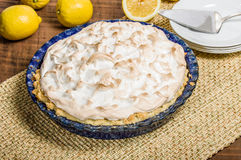 Homemade lemon meringue pie with lemons Stock Photography