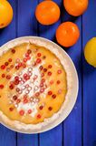 Homemade lemon pie decorated with fresh cranberries and icing su Royalty Free Stock Photography