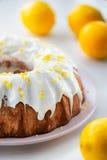 Homemade lemon pound cake. Closeup of a homemade lemon pound cake with fresh fruit Stock Photography