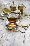 Homemade lemon sugar cookies and cup of hot tea on wooden table Royalty Free Stock Image