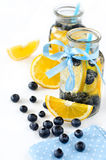 Homemade lemonade with bubbles and fresh fruits isolated. Cold drink in glasses with straws and berries Royalty Free Stock Photography