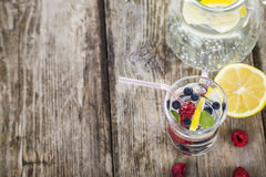 Homemade lemonade with fresh berries on a wooden table.Cocktail Stock Photos