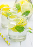 Homemade lemonade with fresh lemon and mint. Closeup Royalty Free Stock Photos