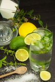 Homemade lemonade with fresh lemon and mint. Cool, refreshing dip in the hot summer. Stock Photo