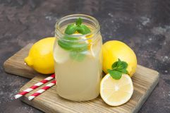 Lemonade. Homemade lemonade with fresh lemon and mint on a stone background Stock Photography
