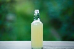 Homemade lemonade in glass bottle on bokeh background Royalty Free Stock Photo