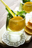 Homemade lemonade with orange and mint. Homemade carbonated lemonade with orange and mint. Selective focus Royalty Free Stock Photo