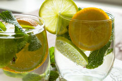 Homemade lemonade with orange and mint. Royalty Free Stock Images