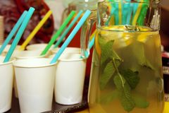 Homemade lemonade from oranges, lemons and mint in a glass jug. royalty free stock photos