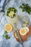 Homemade lemonade. The process of making homemade lemonade with mint and lemon Stock Photos