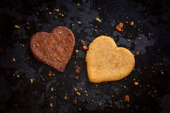 Homemade light and dark heart shaped ginger cookies stock photography
