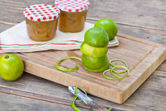 Homemade lime jam with fresh limes Royalty Free Stock Photos