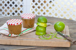 Homemade lime jam with fresh limes Royalty Free Stock Images