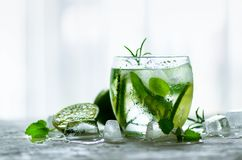 Free Homemade Lime Lemonade With Cucumber, Rosemary And Ice, White Background. Cold Beverage For Hot Summer Day. Copyspace Stock Image - 114680121