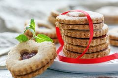 Homemade Linzer cookies in the shape of a heart. Stock Photos