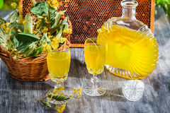 Homemade liqueur made of honey and dry lime leaves Royalty Free Stock Image