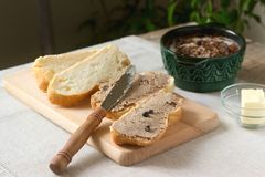 Homemade liver pate with bread and butter. Rustic style. stock photo