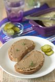 Homemade liver pate with bread and canned cucumber. Rustic style, selective focus. royalty free stock photo