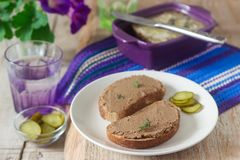 Homemade liver pate with bread and canned cucumber. Rustic style, selective focus. royalty free stock image