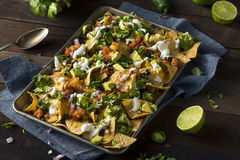 Homemade Loaded Sheet Pan Nachos. With Cilantro Lime Tomato and Onion Royalty Free Stock Photography