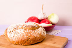 Homemade loaf of bread on cutting board Royalty Free Stock Photos