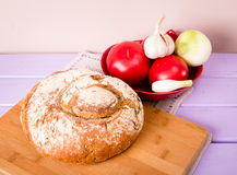 Homemade loaf of bread on cutting board Stock Photos