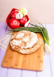 Homemade loaf of bread on cutting board Royalty Free Stock Image