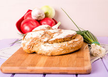 Homemade loaf of bread on cutting board Stock Image
