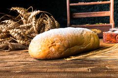 Homemade loaf of bread and ingredients.  Stock Photography