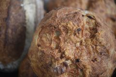 Homemade loaves of bread freshly baked and taken closeup with overhead view. Homemade loaves of bread taken in macro photography with blurred background and royalty free stock photo