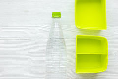 Homemade lunch with green lunchbox and water top view mockup Stock Photos