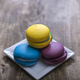 Homemade macaroons on the wooden table Royalty Free Stock Photos