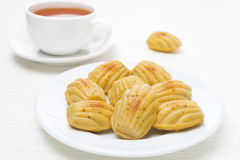 Homemade madeleine cookies and a cup of tea Royalty Free Stock Photos