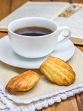 Homemade madeleines with a cup of coffee. Closeup Royalty Free Stock Photography
