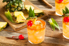 Homemade Mai Tai Cocktail. With Pineapple Cherry and Rum royalty free stock photography